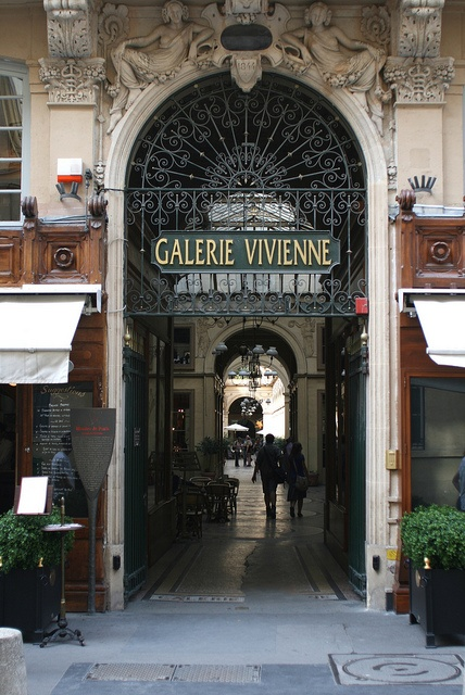 """The Galerie Vivienne is a passage in the second arrondissement of Paris, France. It houses all different kinds of shops. One of the most charming shopping """"passages""""."""