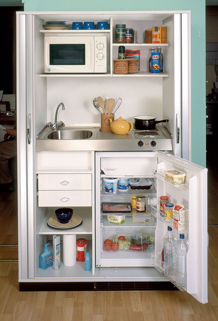 Great use of space! Micro kitchen design at its best. Also, love that you could close it off.