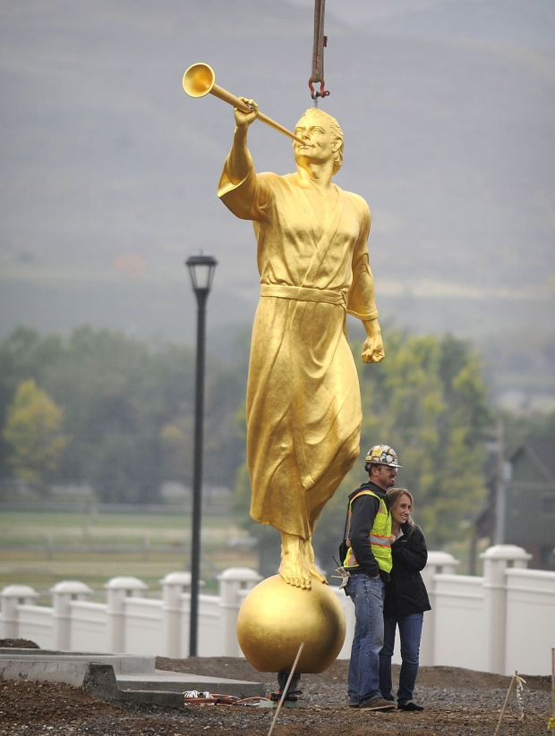 Angel Moroni being prepared to ascend to the spire of the Payson, Utah Temple