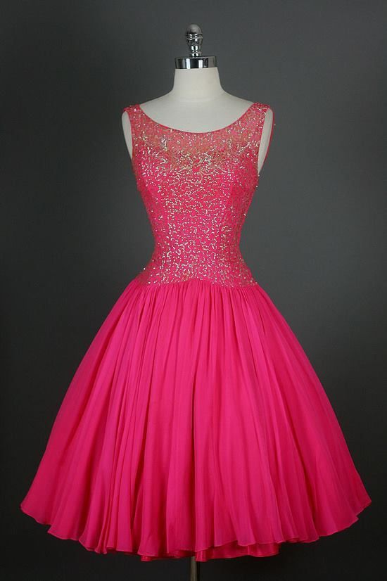 50`s. i'm normally not a bright pink girl, but this is so pretty