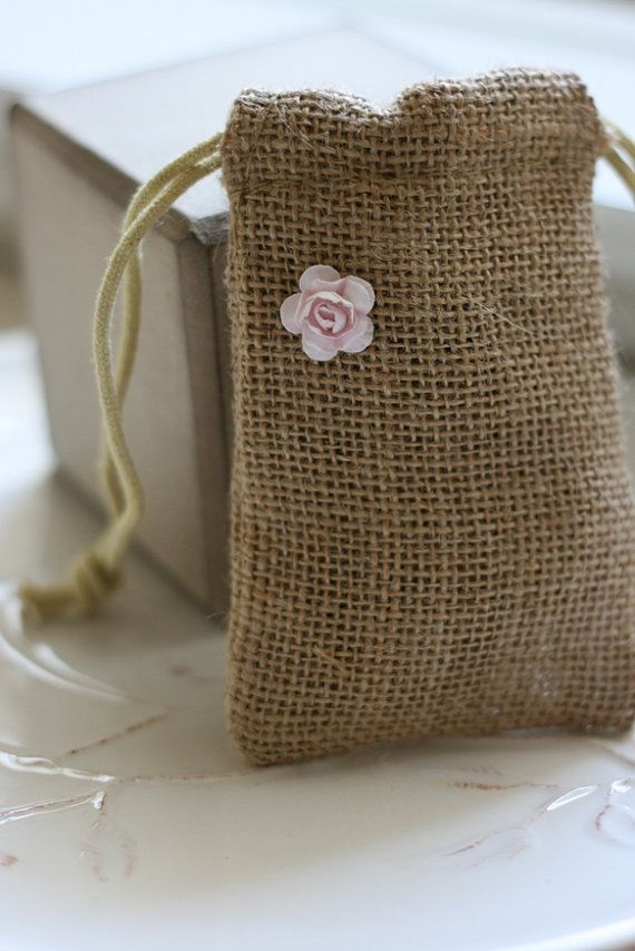 If you're planning a rustic wedding, burlap favor bags are a must-have. Fill with your favorite candies or scented soaps for guests to take to-go. These burlap bags are handmade by Paper Moon by Kat and we think they're adorable.