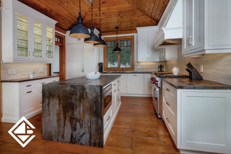 This kitchen you don't see too often. It has a cottage/rustic vibe with the gorgeous granite island countertop that continues throughout the perimeter cabinet countertop. The custom made white cabinetry is gorgeous with a few upper glass inserted cabinets.