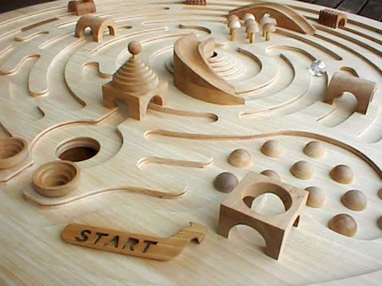Beautiful wooden labyrinth for children. Can just see a big brother setting this up