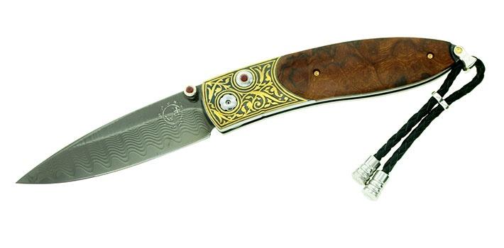 "Monarch: B05-1109 Homestead: black tungsten DLC-coated ""Wave"" damascus blade, Kofgari-inlaid 24kt gold fram, desert ironwood inlay, ruby gemstone, limited edition of 50."