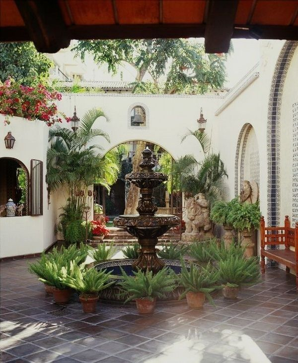 Dreamy Spanish courtyard foundation with potted agave.
