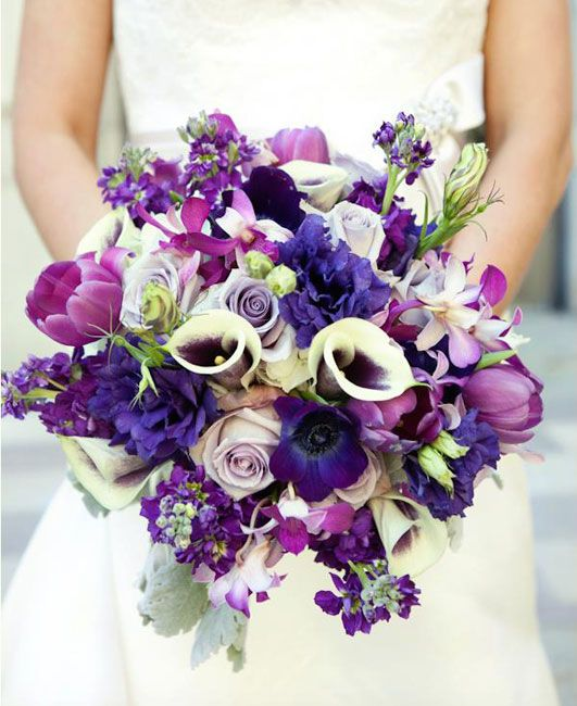 Lovely lavenders, purples, and fushias for the bride - with tulips, fragrant stock, calla lilies, roses, and lisianthus edged in Dusty Miller leaves. Lee Forrest Design