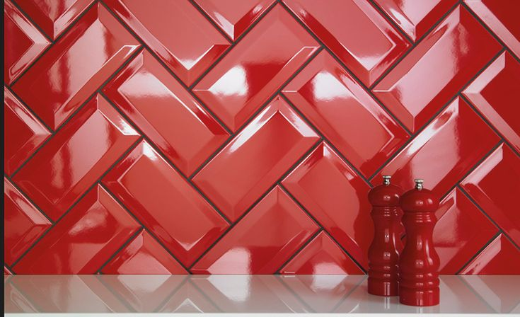 A touch of red in a herringbone pattern looks lovely as a kitchen splashback tile. #kitchensplashbacktiles