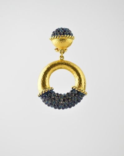 HAMMERED GOLD HOOP: 24 Karat gold plated hammered drop hoop earring with Austrian crystal detail in Navy blue stones. Earring is 2 4/3 inches tall and 1 3/8 inches at  widest point. Earring is a clip. Get a 20% discount with promo code: Olusegun683. $315