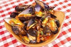 Mussels Saganaki recipe (Greek Midia Saganaki)      1 1/2 kg mussels, washed (50 ounces)     1 glass white wine (dry)     10 cherry tomatoes     1 pepper     1 red onion     1 spring of celery     1 carrot     2 cloves of garlic     1 bunch fresh parsley     100g/3.5 ounces feta cheese (optional)     1/2 cup olive oil
