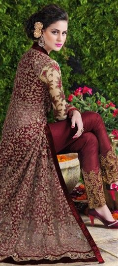 452059 Red and Maroon color family Party Wear Salwar Kameez in Net fabric with Lace, Machine Embroidery, Stone, Thread, Zari work .