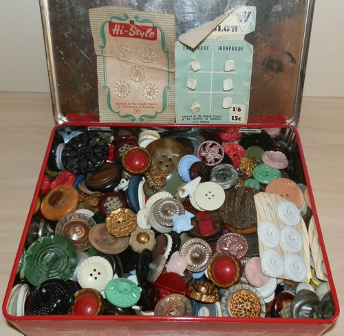 Tin of buttons. All Grandma's had these didn't they? I used to love rummaging through my Grandma's.