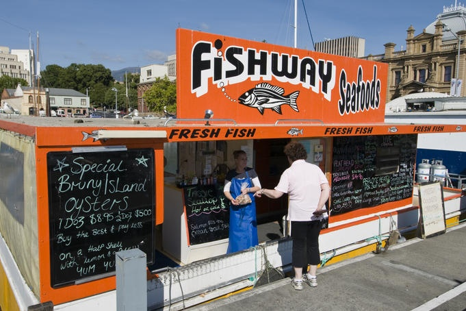 Constitution Dock, Tasmania  Takeawy seafood from one of several floating punts moored in Constitution Dock