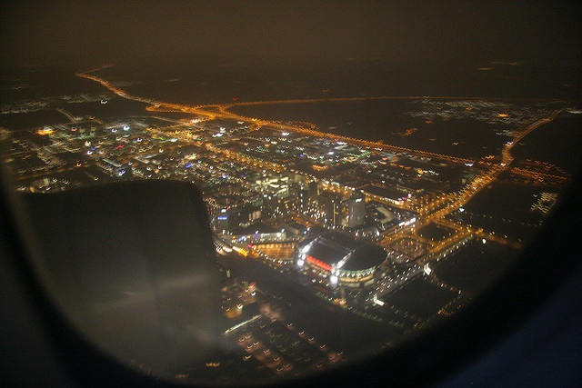 The Amsterdam Arena soccer stadium photographed from Northwest Airlines flight NW34 on an early morning when it was still dark. The left-wing engine of the Airbus A330 can be seen on the left.     Holidays to Amsterdam  Holidays to London  Holidays to Paris
