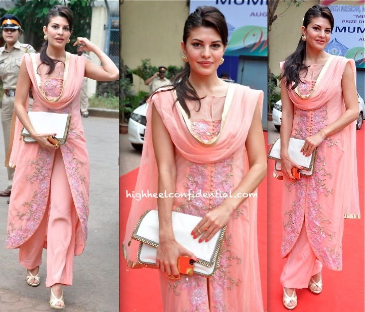 For a recent event in Mumbai, Jacqueline picked a Shehlaa suit. While am not a fan of the tulip-hem kurta and pants, it is the stark white accessories that I have a bigger issue with. The Stella McCartney clutch looks much too jarring against rest of her outfit. That said, waist up she did look sweet!
