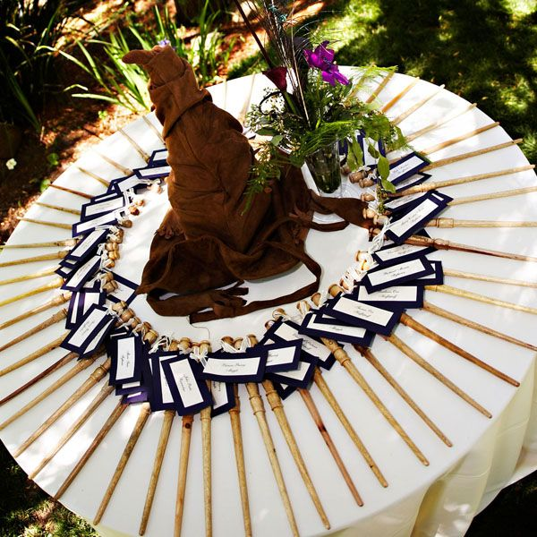 At this Harry Potter themed wedding, the guests were spellbound by these escort cards, complete with personal wand. The tables were sorted into the four houses of Hogwarts (Gryffindor, Hufflepuff, Ravenclaw and Slytherin).