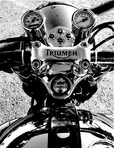 One of his favorite bikes.....Triumph was the first motorcycle he took me on....now he has 2 Harley's and a Triumph.