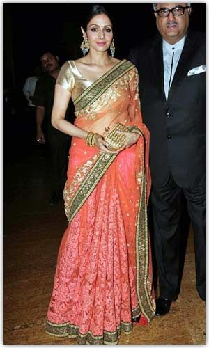 Sri Devi looking good in Sabyasachi Net saree..