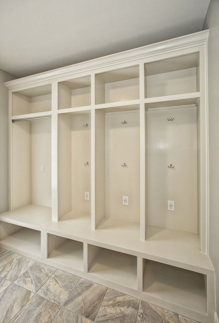 Mudroom cubbies with USB charging station in a laundry room remodel.