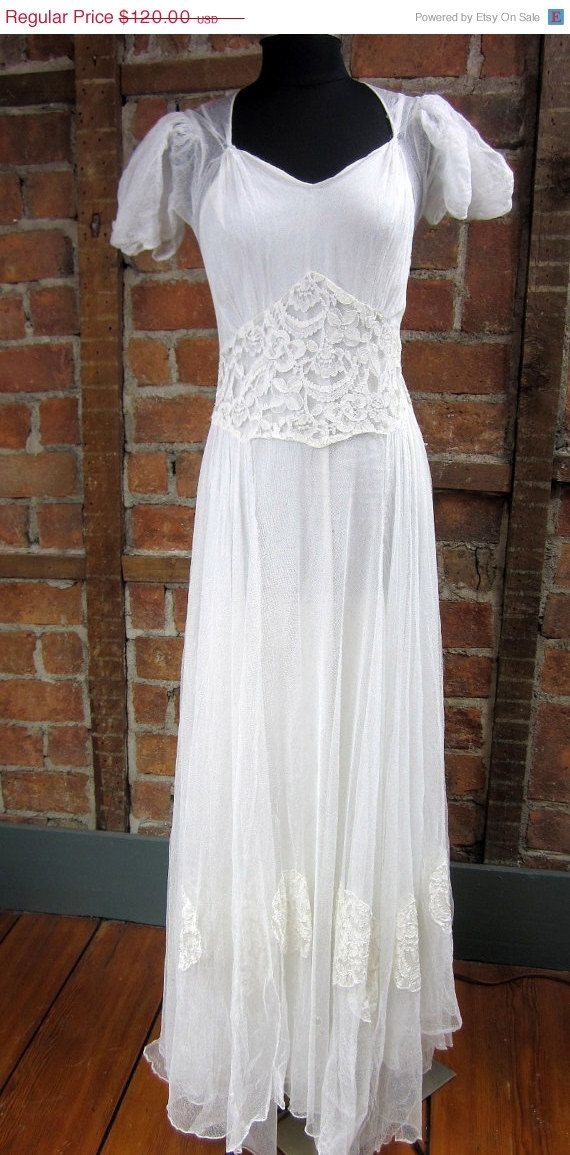 Love Love this Dress...  Even with the issues. This is a lovely gown. Priced accordingly Gauzy Floral Medallions. Netted Wedding gown  Slip attached 2