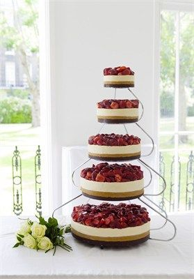 A five tier strawberry vanilla cheesecake, designed by The English Cheesecake Company. ***Throughout October 2012 you can win this wedding cheesecake for your big day.