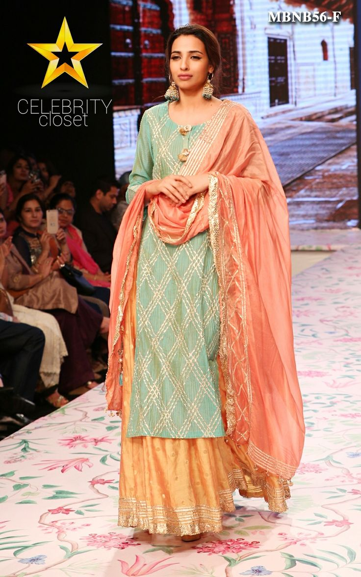 Here comes the new design from Meena Bazaar, a classy combination of graceful colors and designs to make you and your wardrobe feel fresh.It is crafted in chanderi silk, long sleeves,pin tucks and gotta details for festive vibes. This lehanga set comes with chiffon dupatta with gotta border detail and yellow lehenga with golden border.Adorn it to occasions like mehendi, sangeet, ring ceremony etc and let the flattering remarks keep rolling in.