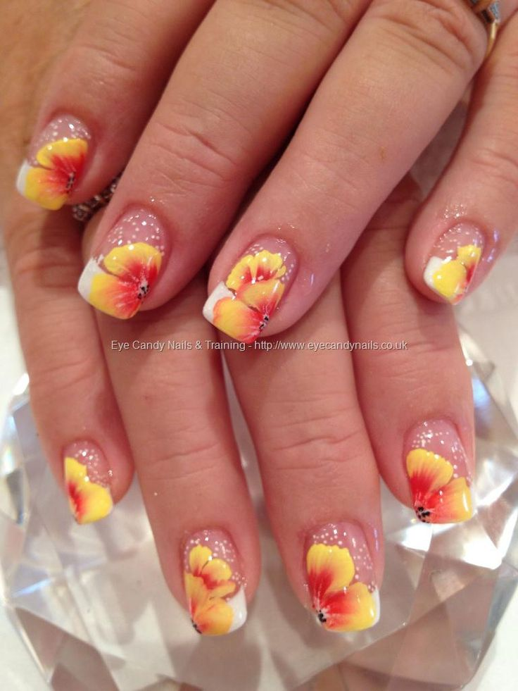 Standard white tip french manicure with beautiful orange & yellow 1 / One stroke free hand flowers nail art floral    One of my absolute favorites! Which I could learn