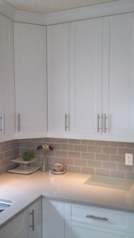Taupe glass backsplash, clamshell cesarstone countertop