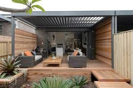 Mark, Duncan and Dale's outdoor space.  The vergola is a great way of creating a useable outdoor space.  Also love the use of wood in this design