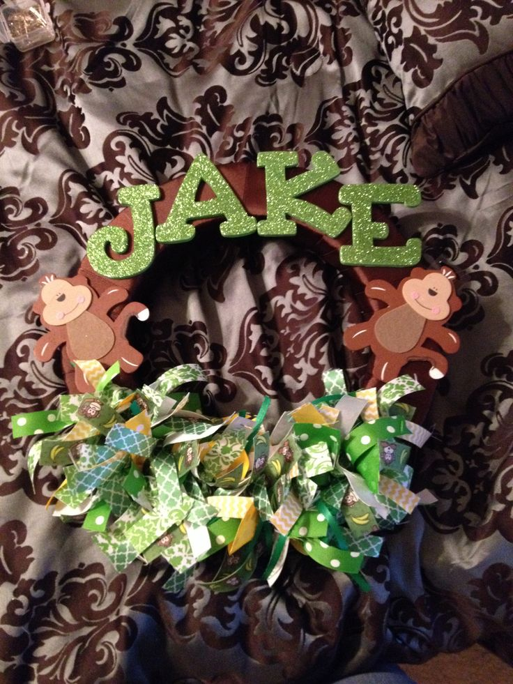I made this door wreath for a safari baby shower! To match monkey and green bedding. Can use at the hospital door at birth and in the nursery