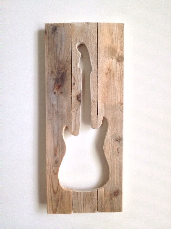 A personal favorite from my Etsy shop https://www.etsy.com/listing/162557155/rustic-wall-decor-guitar