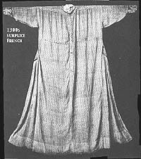 """Extant piece: """"1300s surplice, French. National Museum, Munich. Note band of trim across chest, shoulders, and vertical in center. Godets at side reinforced (?) with embroidered patches that match cuffs.  From Kohler, who notes that it is of """"white linen, braided with blue and red.""""  additional info from Nancy Stengel"""""""