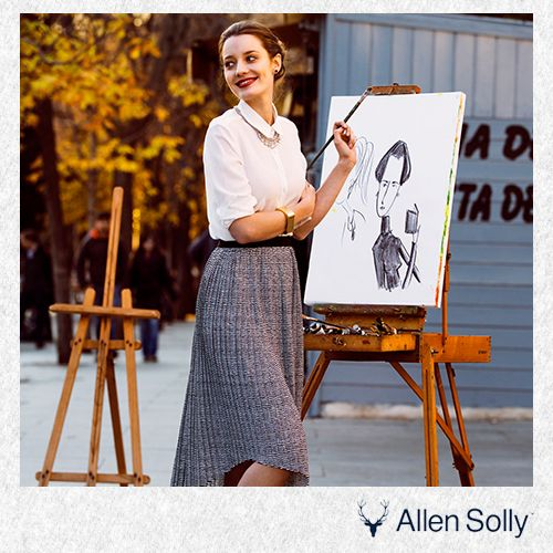 Offset the colours on the canvas with a white blouse paired expertly with a grey skirt.