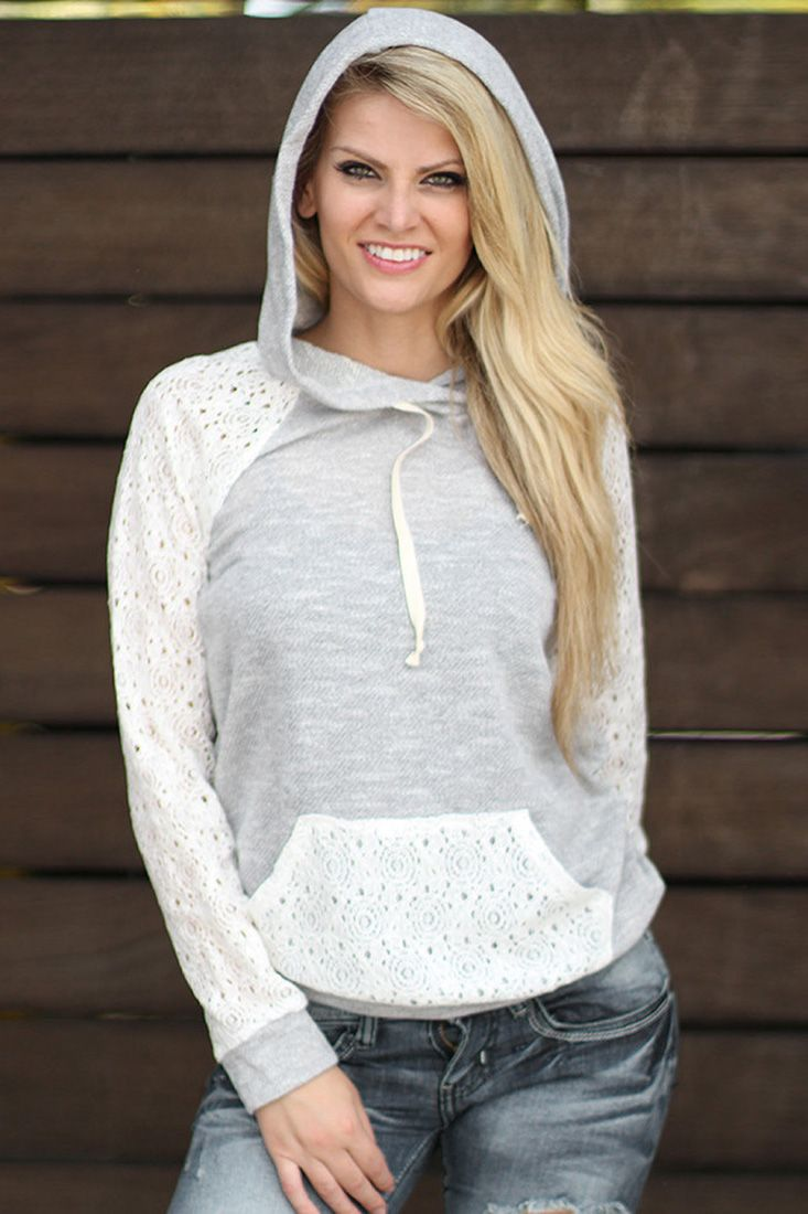 The hooded sweatshirt is featuring lace paneled, drawstring design, patch front pocket and long sleeve.
