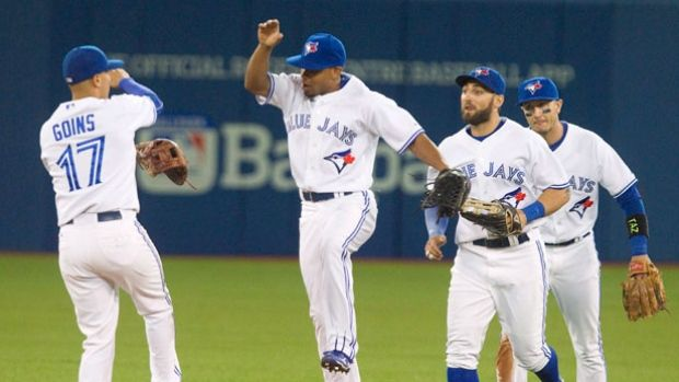 Ryan Goins, left to right, Ben Revere Kevin Pillar and Troy Tulowitzki celebrate after they defeated the Oakland Athletics 10-3 in Toronto on Wednesday.