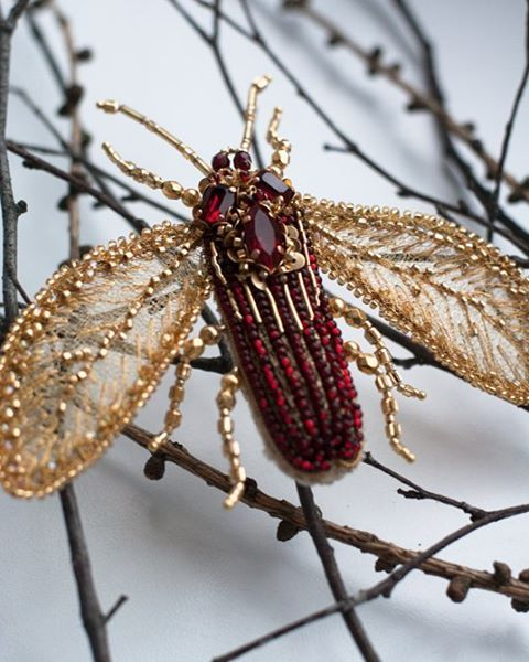 Ruby and golden bug by #eveanders hides its velvet belly from view.  Рубиново-золотой жучок от #eveanders скрывает от глаз свое бархатное брюшко. #jewelry #accessories #embroidery #insectart #insectaccessories #goldwork #coutureembroidery #shopping #instafashion #love #beautiful #instagood #design #styles #tallinn #brooch