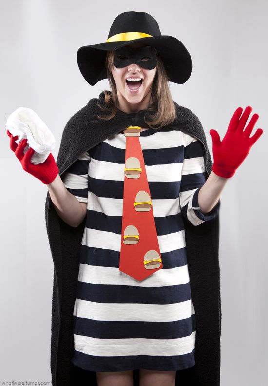 Hamburglar - Key Elements:      Striped Dress     Black Cape     Black Hat with Yellow Band     Robber's Mask     Hamburger Necktie     Red Gloves...