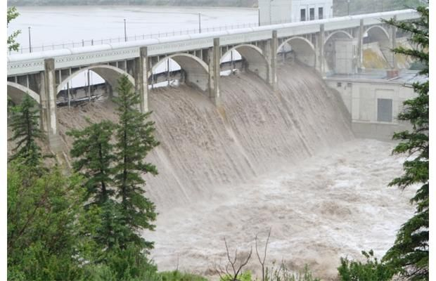 Water pours over the top of the Glenmore Dam as flooding paralyzed the Calgary on Friday morning June 21, 2013. Photograph by: Gavin Young, Calgary Herald