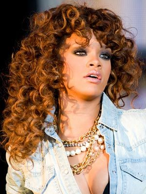 Rihanna performs at the V Festival at Hylands Park.