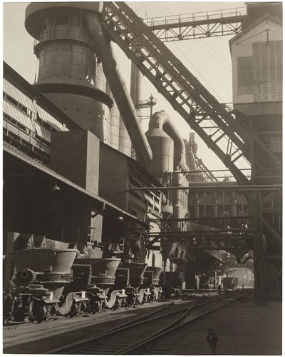 Charles Sheeler, American, 1883–1965, Ford Plant, River Rouge, Slag Buggies and Blast Furnace, 1927; gelatin silver print. Courtesy the Museum of Fine Arts, Boston, The Lane Collection.