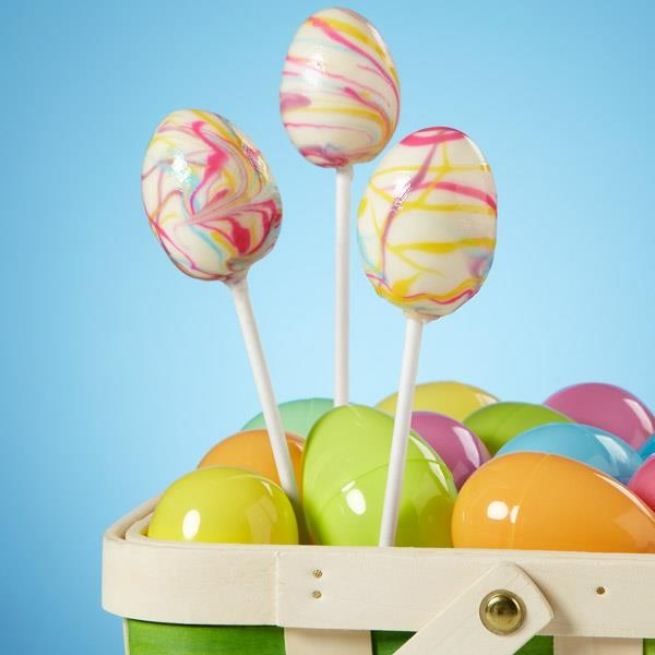 Wilton Tie Dyed Easter Egg Cake Pops. Basically, make cake-frosting pop recipe, form in plastic eggs, etc. Dip in white candy melts then drizzle with color candy melts. Such delish fun that wee ones can help with.