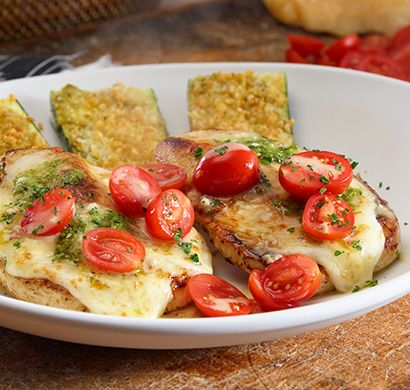 Chicken Margherita- Grilled chicken breasts topped with fresh tomatoes, mozzarella, basil pesto and a lemon garlic sauce. Served with parmesan crusted zucchini. 590 calories