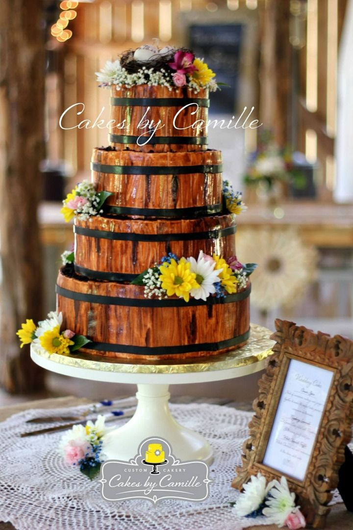 Rustic wooden barrel wedding cake, Cakes by Camille, LLC. Venue: The Barn at Cedar Grove, Stand: Sarah's Stands, a Cake stand Company