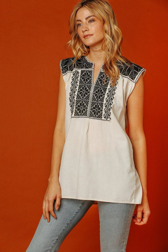 Dressed up or down, you'll want to wear the San Vicente Sleeveless Top all over town! This breezy cottonblouse features a chic embroidered neck and a relaxed b