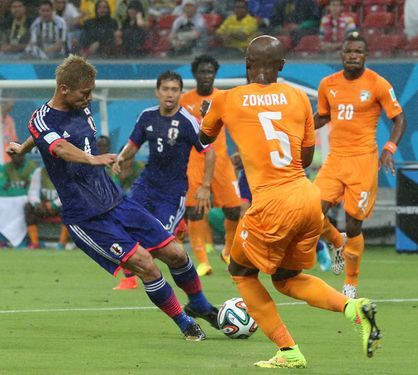 Japan's Keisuke Honda boots the Samurai Blue's first goal against Ivory Coast during the group C World Cup soccer match