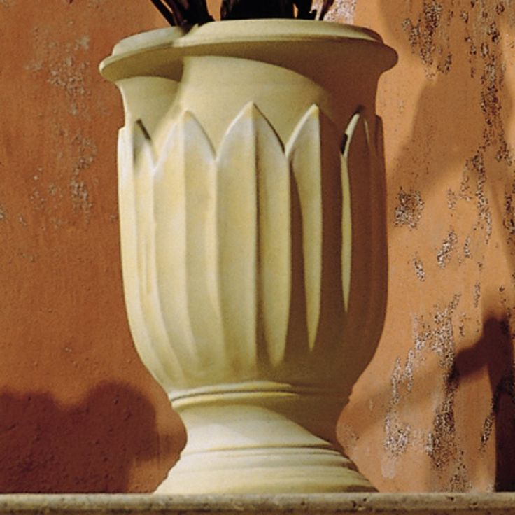 200 - Round Resin Freda Urn Planter - What We Like About This Planter The Freda Urn brings a touch of class wherever it goes. A dramatic but graceful leaf pattern encircles the surface,...