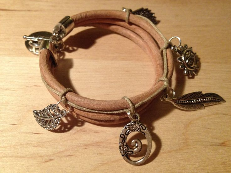 Natural strap with metal elements