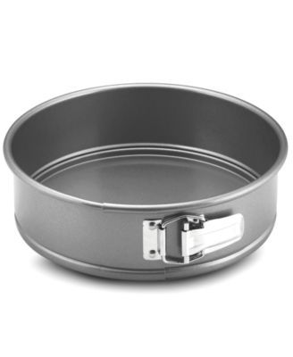 """Anolon Advanced 9"""" Springform Pan $16.99 Top form! For champion cheesecakes and pastries, count on Anolon's 9"""" spring form pan. Crafted of heavyweight carbon steel for even heating and browning, the pan features a folded construction for extra durability and warp-resistance. New proprietary coating ensures superior release and makes cleanup a snap. Lifetime limited warranty."""