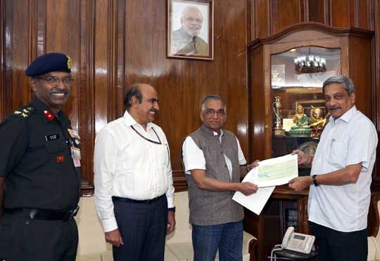 The Head of Corporate Social Responsibility (CSR), Bajaj Auto Ltd, Shri CP Tripathi presented a cheque of Rs. One crore to the Defence Minister Shri Manohar Parrikar as the donation to the Armed Forces Flag Day Fund (AFFDF) here today.