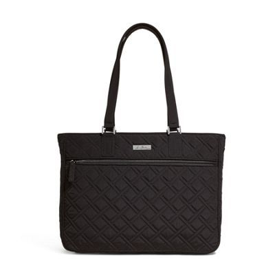 Carry the day with this fashion-forward workbag that goes beautifully from desk to drinks. Inside the extra-roomy interior, you'll find enough space for everything you need to take on the day: wallet, phone, iPad, files, even a safe spot for your laptop. Interior pockets keep everything organized, and a recessed zip-top closure keeps contents secure.