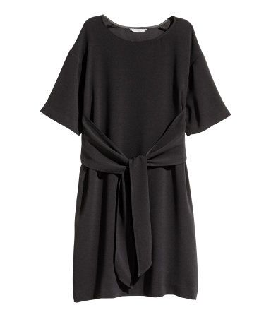 Black. Short, straight-cut dress in crêped woven fabric with dropped shoulders, short sleeves, and tie at front. Unlined.